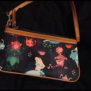Dooney and Bourke Alice in Wonderland wristlet.
